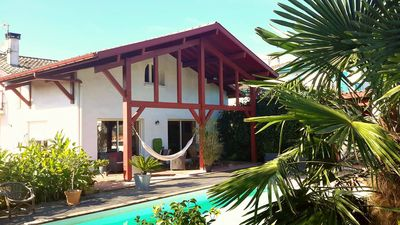 Photo for Villa Arcangues neo-Basque, swimming pool and palm trees 10 minutes from Biarritz