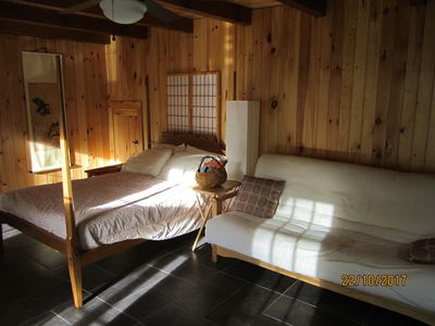This is the handmade pencil post double bed and double futon with handmade frame