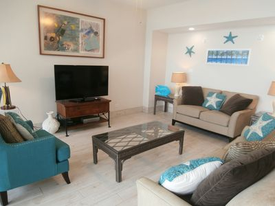 Photo for Beach Accommodations With Modern Conveniences. Remodeled Coastal Condo.