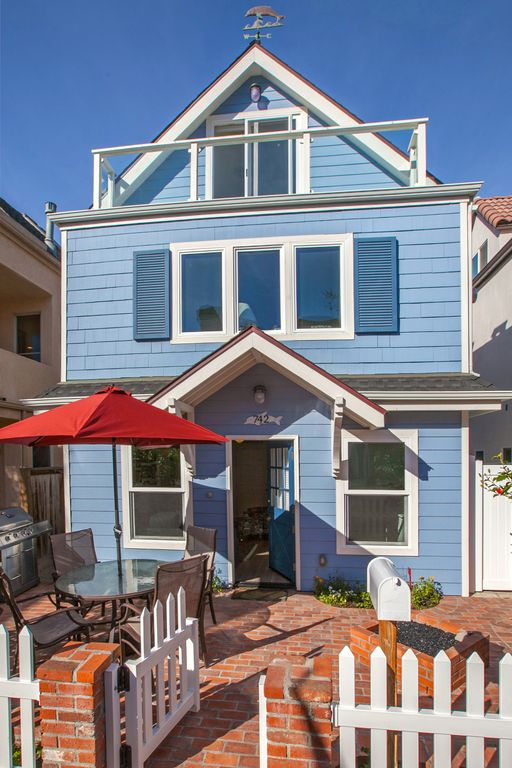 Standalone cape cod style house on one of mission beachs prettiest courtyards