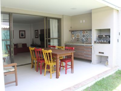 Photo for Vilage duplex in Itacimirim with private barbecue, pool and tennis court