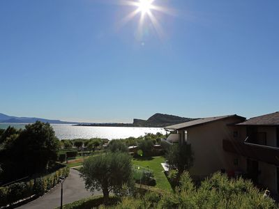 Photo for Lovely apartment in charming holiday park with beach on lake Garda