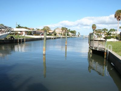 Photo for Tranquil waterfront with heated pool, dock and walk to beach