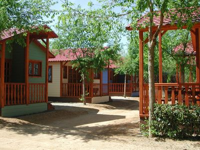 Photo for Cottage in a charming campground with many facilities, just 200 metres from the beach