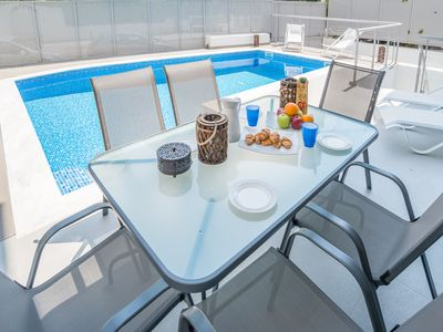 Photo for Voula luxury 2-level apartment w/ private pool