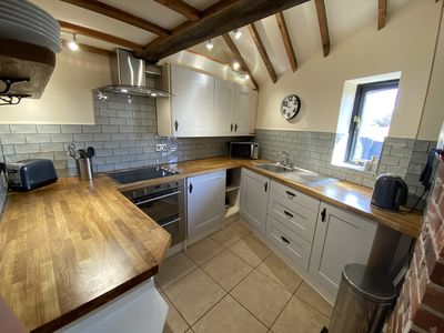 Photo for Superb character 2 bed barn conversion ideal for couples, families and pets