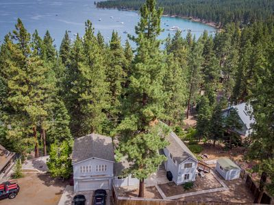 Photo for Modern home w/ an outdoor fireplace, hot tub, & private beach - close to skiing