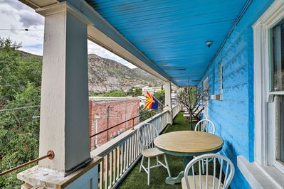 Dine al fresco on the balcony of this Bisbee vacation rental apartment.