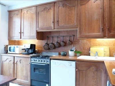 Spacious, fully equipped kitchen with Italian tile floors, marble back splash