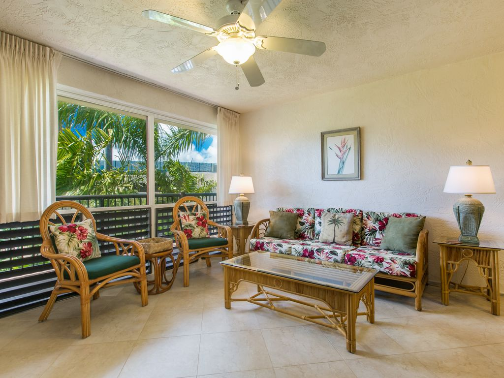Living Room With Large Windows For Lovely Views Of Tropical Garden