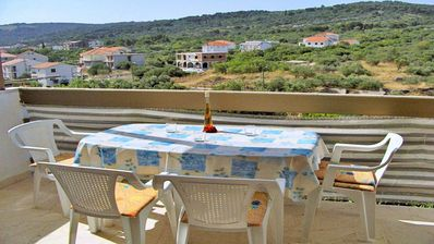 Photo for Three bedroom apartment with balcony and sea view Slatine (Čiovo)