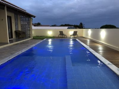Photo for Polynesian chalets, pool, barbecue and close to the beach
