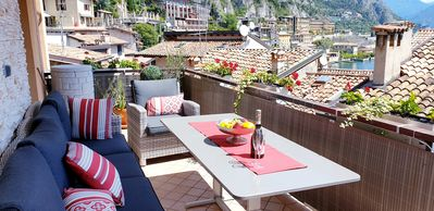 Photo for Noble, spacious 3 bedroom lake view apartment in the old town of Limone