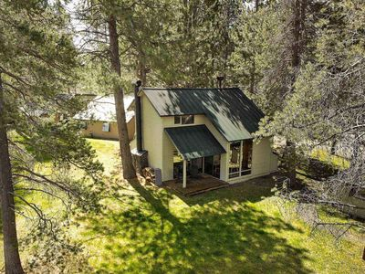 Photo for Cozy 2 BR cabin, 6 SHARC passes. Near bike path. Community pool. Fireplace. Perfect family vacation.