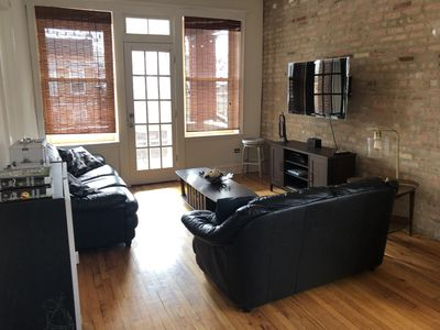 Photo for Sun Drenched, Exposed Brick Loft in Ukrainian Village With Private Balcony!