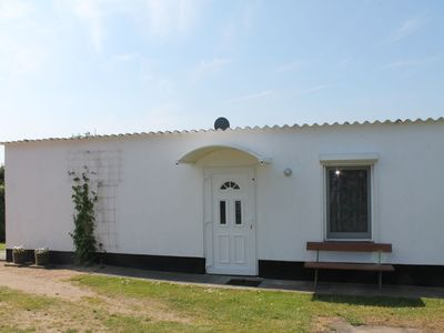 Photo for Lovely holiday bungalow with cosy sitting area in the open air