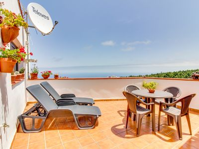 Photo for Adorable villa w/ panoramic views, furnished balcony - close to beach & town