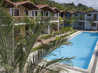 Photo for Apt 2 bedrooms with pool in a condominium on the beach of Taperapuan, 500m Beach