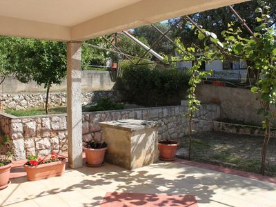Photo for Two bedroom apartment with terrace and sea view Lun (Pag)