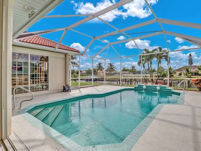 Photo for Gorgeous, Newly Listed, SE Cape Coral Gulf Access Canal Home! Heated Pool, Free Parking & WiFi!