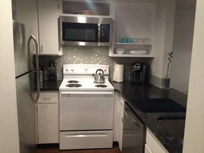 kitchen with new fridge, dishwasher, and microwave.