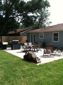 view of back of house with patio and outdoor kitchen