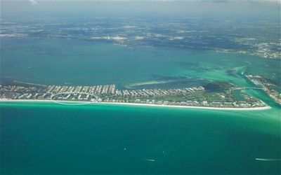 Photo for Greenbelt view from this condo in a Beachfront Community at Beach Place on Longboat Key, FL