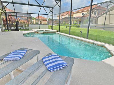 Photo for Pretty 5 Bedroom Home on Gated Community. Has Pool, Spa & Games Room. Only 15 mins from Disney.