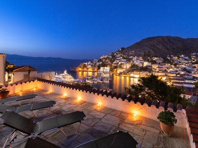 Photo for Traditional stone house overlooking Hydra port , with large terrace gardens