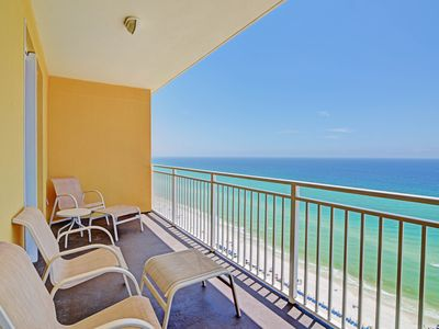 Photo for Superbly located beachfront condo near attractions - steps from pool & beach!