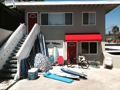 It is the upstairs unit with balcony and beach gear