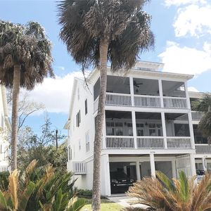 Photo for 5Bedroom/4bath beautifully appointed, screened porches, short walk to beach