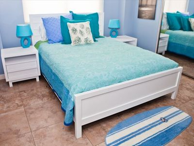 Pier room, comfortable queen bed, private bath/shower. Overhead fan. Closets.