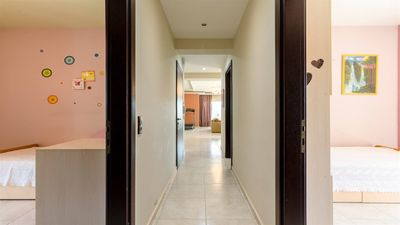 corridor from the bedrooms to the living room and kitchen.