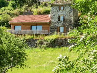 Photo for Beautiful stone cottage with fireplace and cozy decor