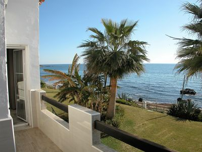 Photo for Playa Lucera - Fantastic 3 bedroom front line beach  duplex apartment with open sea views from its 2 terraces
