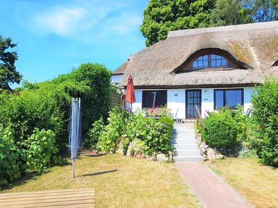 Photo for Thatched cottage and lake - thatched cottage overlooking the lake