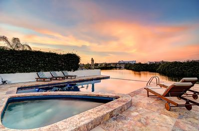 Relax next to the pool and hot tub in this Custom built luxury home in El Cid.