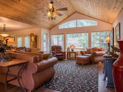 Photo for Beautiful cabin nestled right on the Clark Fork River surrounded by mountains.