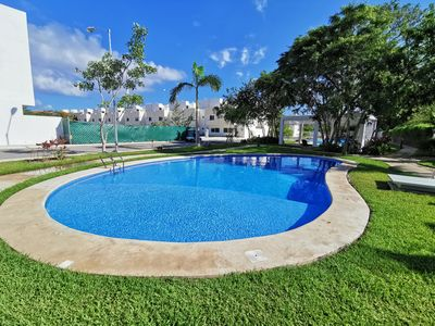 Photo for Family-friendly, relaxing, getaway home w/ shared gardens and pools.