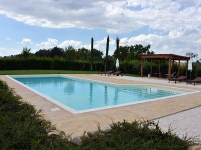 Photo for NIGHT panoramic apartment in farmhouse with pool, in the Marche hills.