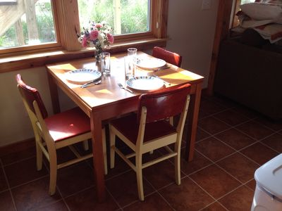 Dining table with expandable leaves hidden underneath.