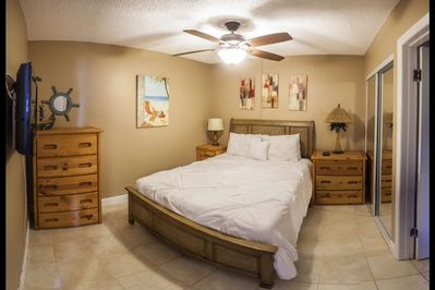 Guest bedroom with a new queen size mattress, complete with plenty of drawer and closet space to store your belongings.