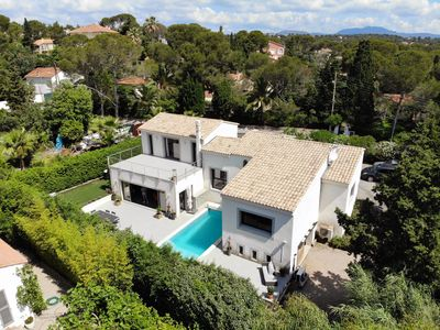 Photo for CONTEMPORARY VILLA with pool beaches on foot and near Santa Lucia harbor
