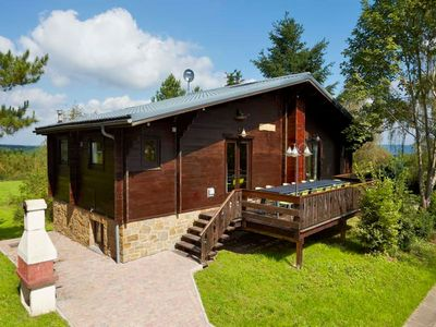 Photo for Comfortable chalet for 14 people, with sauna, located in the holiday park 'Le Cheneau' in Hour / Hou