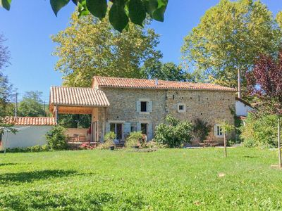 Photo for Authentic house with a large garden located directly on the Aveyron River.