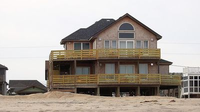 Photo for Beautiful Oceanfront cottage ...just walk out the door and you are on the beach.