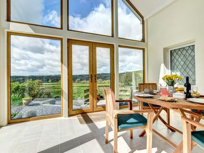 Photo for This enchanting holiday cottage, set in the very heart of Wales, is full of period features, beautif