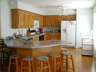 spacious kitchen with breakfast bar