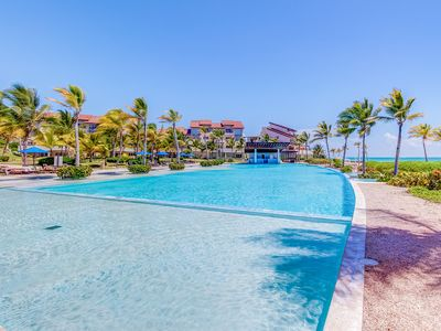 Photo for Beachfront apartment w/ plunge pool, terrace & resort pool - steps to beach!